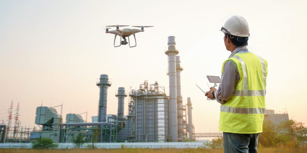 Drone inspection. Operator inspecting construction turbine power plant